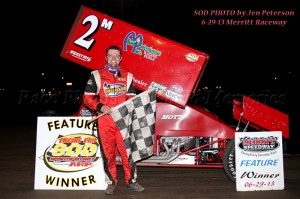Dustin Daggett in victory lane at Merrit Speedway. - Jennifer Peterson Photo