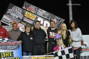 Greg Wilson with his family and crew in victory lane after winning the Bob Reynolds Memorial at Waynesfield Raceway Park. - Bill Weir Photo
