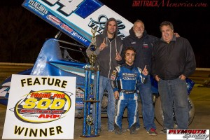 RIco Abreu and crew in victory lane after winning Saturday night at Plymouth Speedway. - Jennifer Peterson Photo