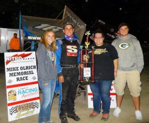 Ryan with Olrich family and trophy